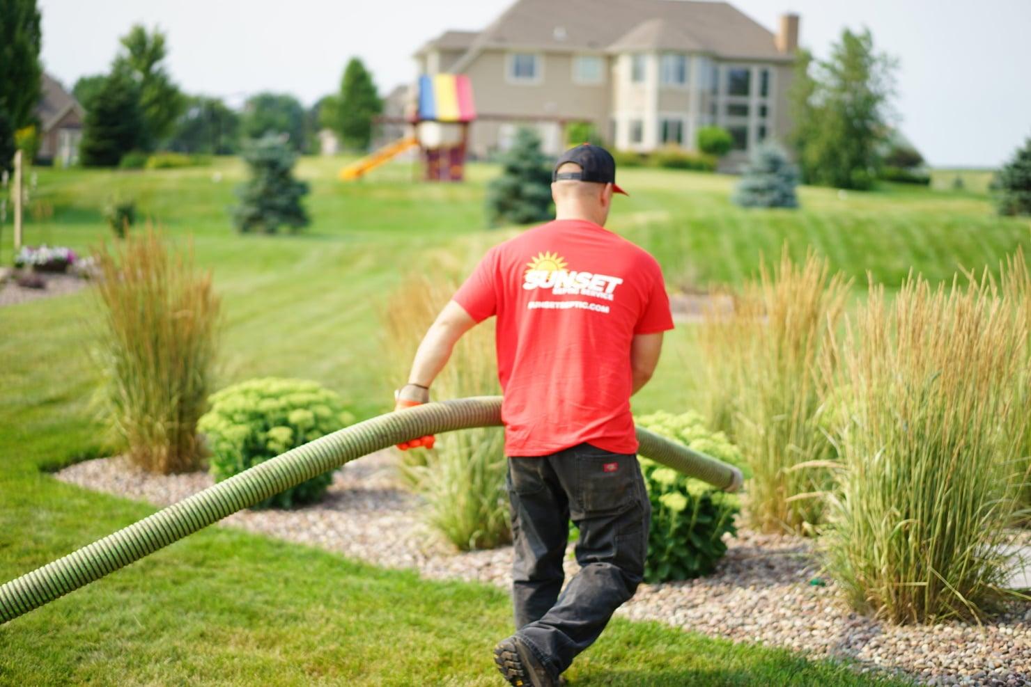 sunset-septic-worker-pulling-hose